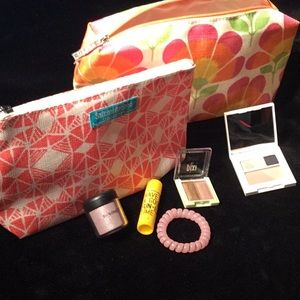 Two make up bags new with make up  and hair tie